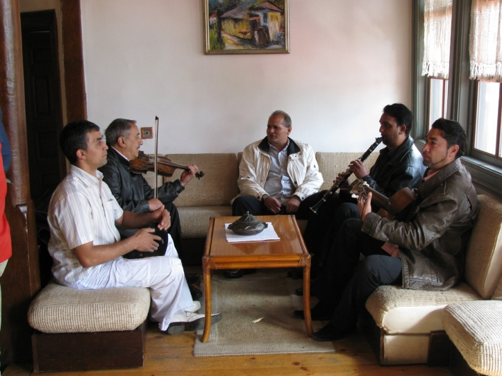 A group of Romani musicians warming up for a gig in Vranje.